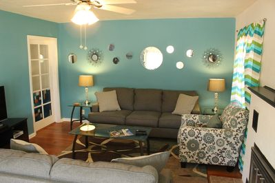 Bright and comfortable living room with flat screen TV, Apple TV and Netflix.