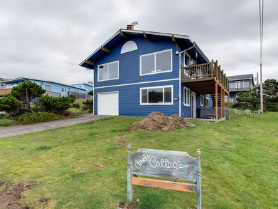 Photo for Ocean view home steps from the beach w/ private hot tub & game room - dogs OK!