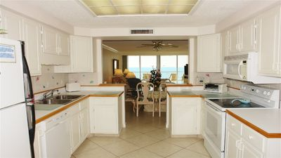 """TOWER 1 - COOK WHILE WATCHING THE DOLPHINS OR THE 35"""" FLAT SCREEN TV."""