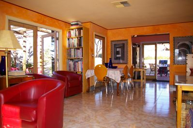 Living room and kitchen have six French doors, leading to three terraces.