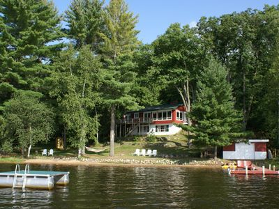 Eagle Pines Cabin on Dam Lake. Sandy beach, swim raft, kayaks, SUPs & paddleboat