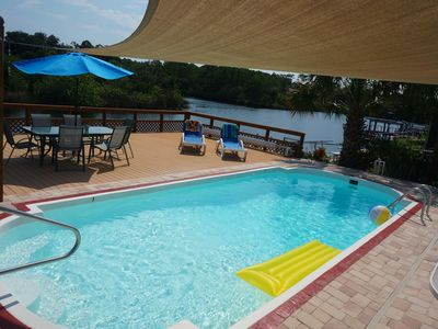 Photo for 3BR Waterfront Oasis W/ Private Heated Pool and Spacious Deck