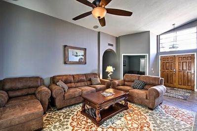 The entertainment room includes ample seating and a flat-screen cable TV.