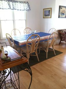 Dining table sits 6; extra table chairs available plus deck table and chairs