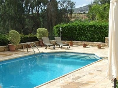 Photo for Large Detached Villa On Private Grounds. Private Pool. Opposite Coral Bay Beach