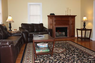 Sitting room with big screen HD TV, pull out sofa and electric fire logs