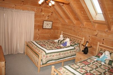 Large bedroom over kitchen with 2 queen beds & private bath.