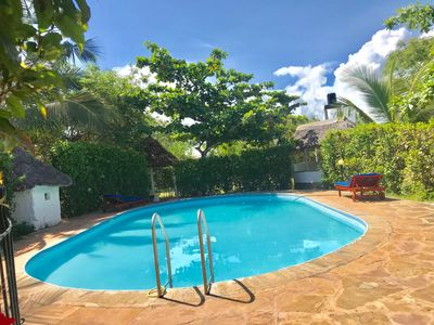 Photo for family friendly cottage with fenced swimming pool the only one in Diani Beach.