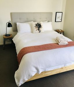 Master Bedroom with queen Size Bed  and views of Flinders St Station