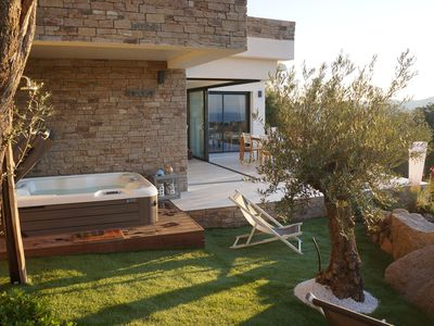 Photo for Stone house with panoramic views over the bay of Figari, outdoor spa