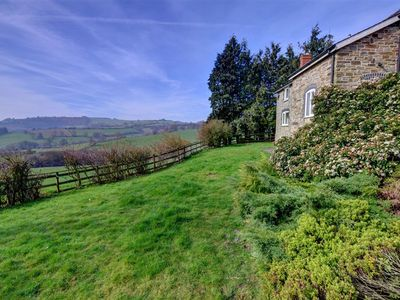 Photo for One mile from Norton between Presteigne and Knighton is Black Patch a spacious farmhouse with four b