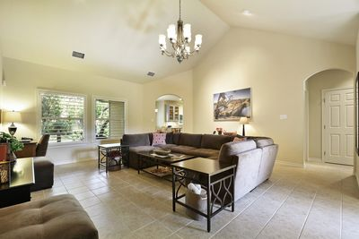 Living room - The spacious family room has cathedral ceilings and picture windows overlooking the lush yard.