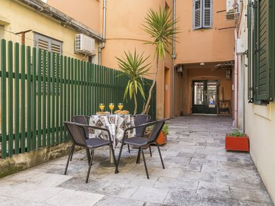 Photo for Charming apartment with patio in the very center of Split