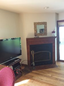 Large flat screen in living room next to fireplace