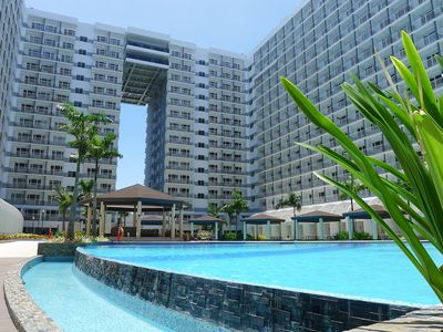 Photo for Ultra-Modern 1BR Condo near Mall of Asia includes Aircon, BROADBAND + Cable