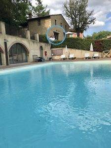 Photo for Elegant and comfortable apartment with private garden in San Gimignano with a view over the pool