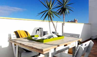 Photo for Lovely apartment with big terrace beside the beach