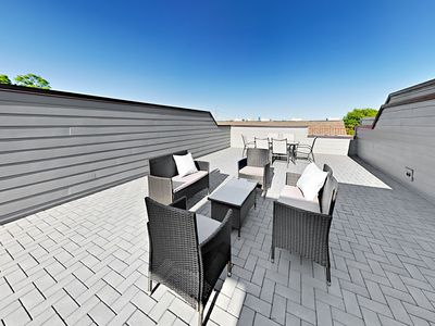 Rooftop Deck - Unwind on the private rooftop deck with ample seating.