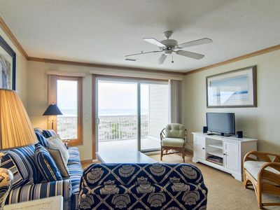 Photo for Coastal style condo nestled in the dunes at the north end