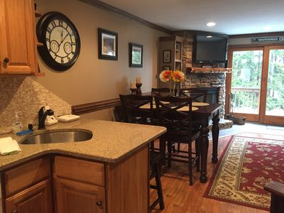 Kitchen open to dining and living area