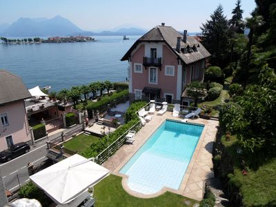 Photo for Villa with pool, facing the lake, in a unique location with beautiful views