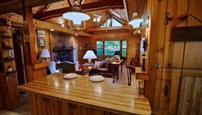 Kitchen has breakfast bar with additional seating. - Kitchen has breakfast bar with additional seating.