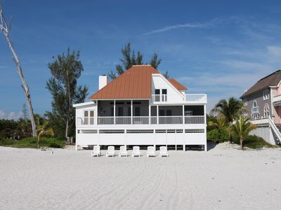 Photo for Villa Island Getaway - Right on the beach with your own dock and Boat included.