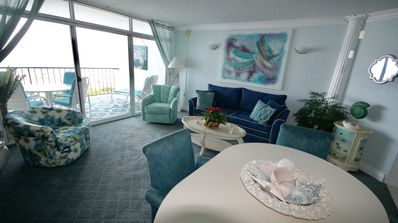 Another view of living area with the ocean front balcony straight in front