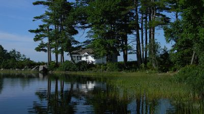 Photo for Whispering Pines Cottage - Surrounded by Pemaquid Lake with beautiful views