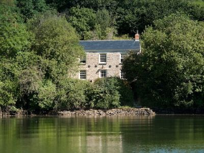 Photo for A magical waterside cottage, surrounded by historic kea plum orchards, yet close to Truro