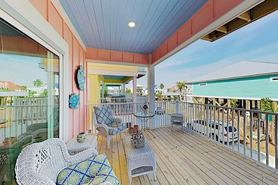 Deck - Take in the coastal breeze on the covered deck.