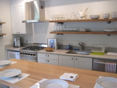Kitchen with open shelving and stainless appliances