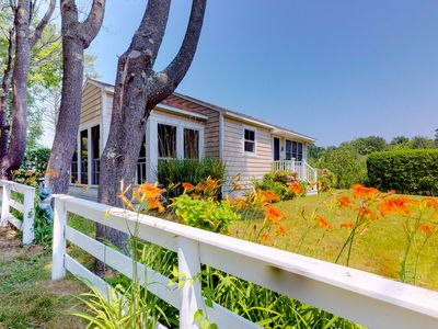 Photo for NEW LISTING! Charming cottage w/pleasant outdoor space, short walk to the beach