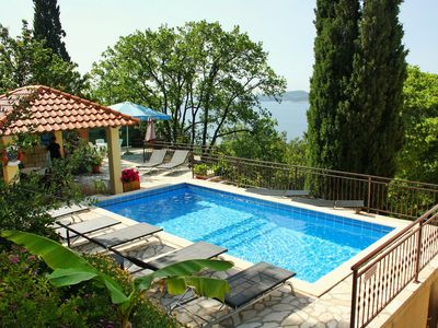 Photo for Lovely apartment for 4 guests with pool, A/C, WIFI, TV, balcony and parking