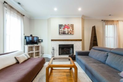 Two large couches will let a bigger group gather in front of the fireplace or TV