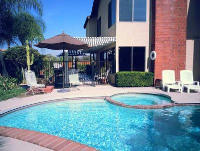 Just a typical California day. Pool, spa, covered patio, BBQ, patio table.