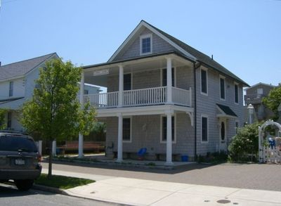 A dozen houses to beach, great 2nd floor porch with backyard grill and shower