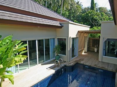 Pool and deck on the living room side (from top of our waterfall)