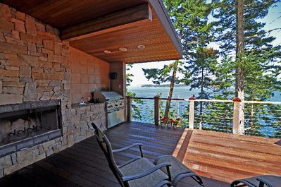 The deck offers a fireplace and BBQ area.