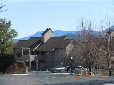 One building in the complex with mountain view in background.