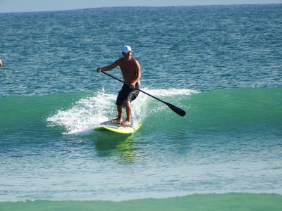 Tom, Catching a wave on a popular surf break right in front of the condo