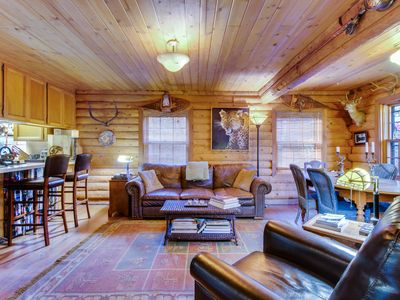 Photo for Unique dog-friendly  log cabin w/resort amenities like a shared pool & hot tub