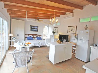 Photo for Charming beach cottage,  only 1 Minute Walk From the Sand Beach