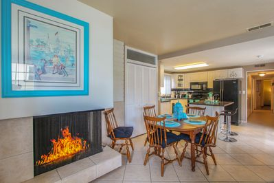 Dining Area - A gas fireplace warms the 6-person dining area.