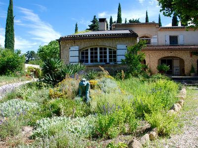 Photo for Provencal farmhouse with beautiful fenced park and large pool in Lauris