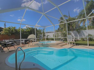 Photo for 3 Bedroom with private pool home - Indian Rocks Beach - Sweet Escape Cottage