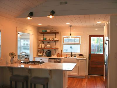 Photo for Renovated little cottage in walking distance of the Bentonville square