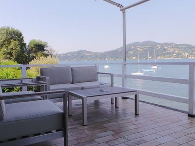 Photo for Contemporary lakeside villa enjoying direct lake access. WIFI. BBQ. Walking distance to restaurant and shop.
