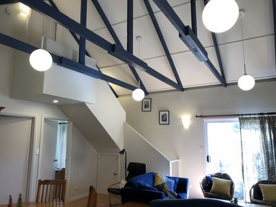 A spacious living room with a cathedral ceiling