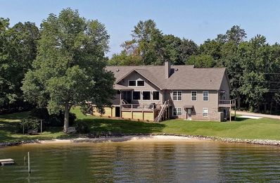 Nowhere else on Lake M. has a new home, fantastic view & a real lake sand beach!